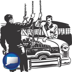 auto mechanics hoisting an engine out of a car with chains - with Connecticut icon