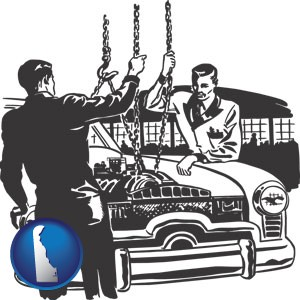 auto mechanics hoisting an engine out of a car with chains - with Delaware icon