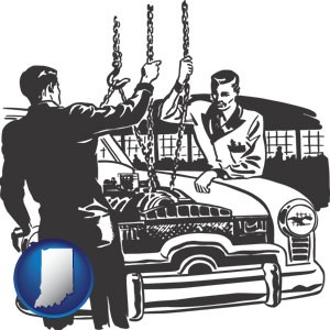 auto mechanics hoisting an engine out of a car with chains - with Indiana icon