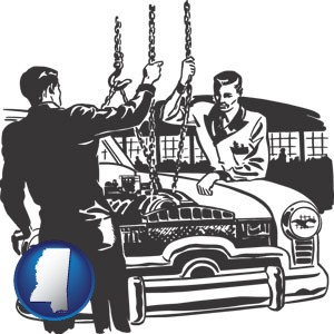 auto mechanics hoisting an engine out of a car with chains - with Mississippi icon
