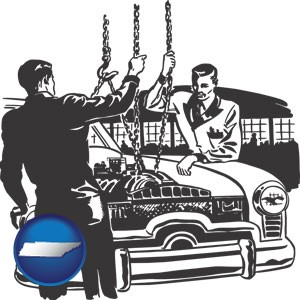 auto mechanics hoisting an engine out of a car with chains - with Tennessee icon