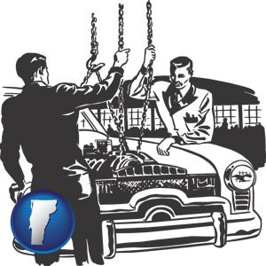auto mechanics hoisting an engine out of a car with chains - with Vermont icon