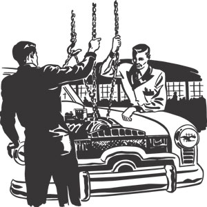 auto mechanics hoisting an engine out of a car with chains
